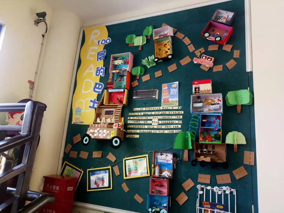 幼儿园以童玩丁信为理念,利用生活中常见的材料,如纸箱纸盒,树枝